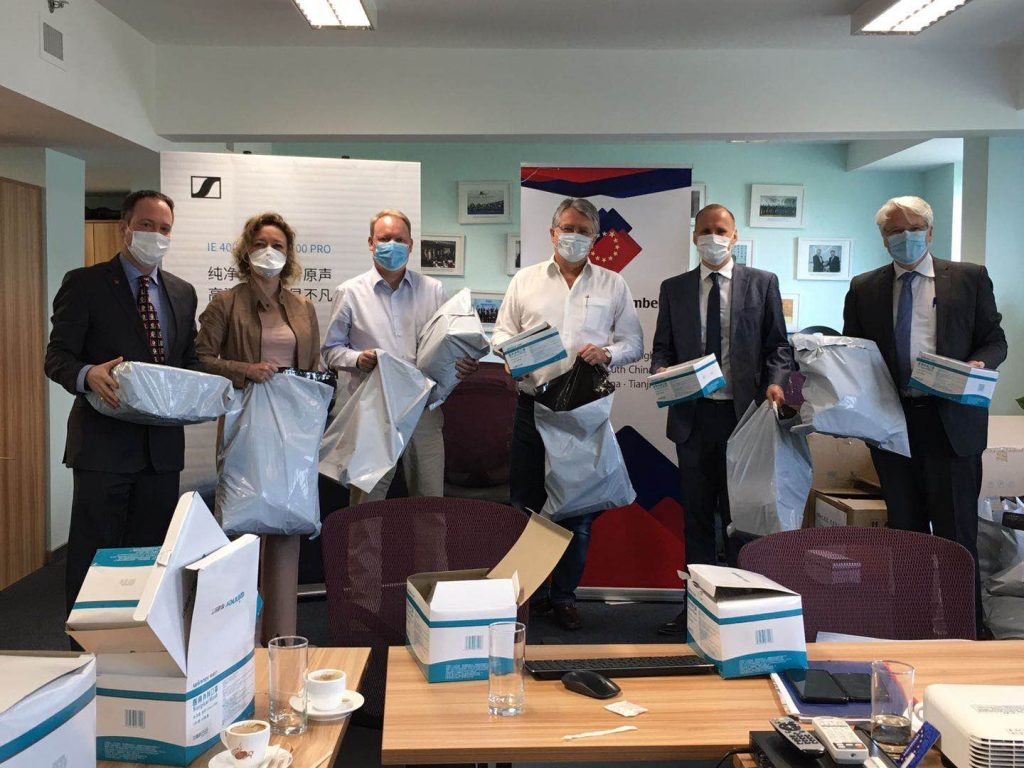 European Chamber staff preparing masks for shipment